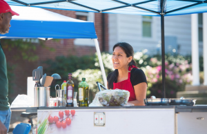 RebelWell Nutritionist Mariana Jurs serves up fresh food for fair participants.